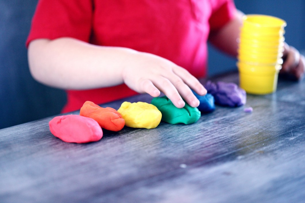 Gay pride coloured play dough being moulded