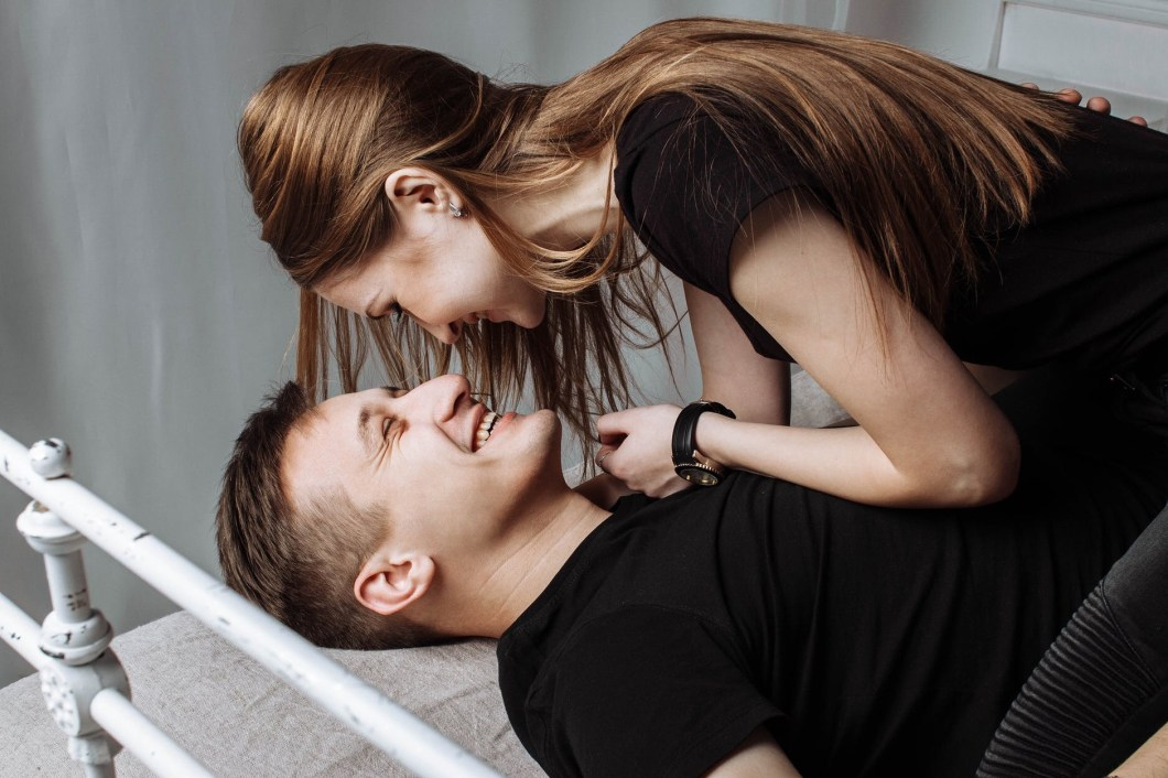 Woman on top of a man