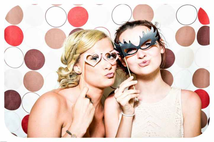 two women in party masks