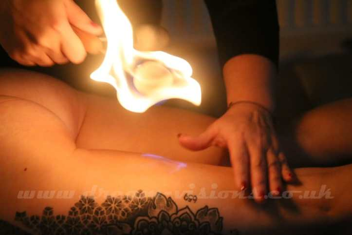 fire play with wands to the back of the legs