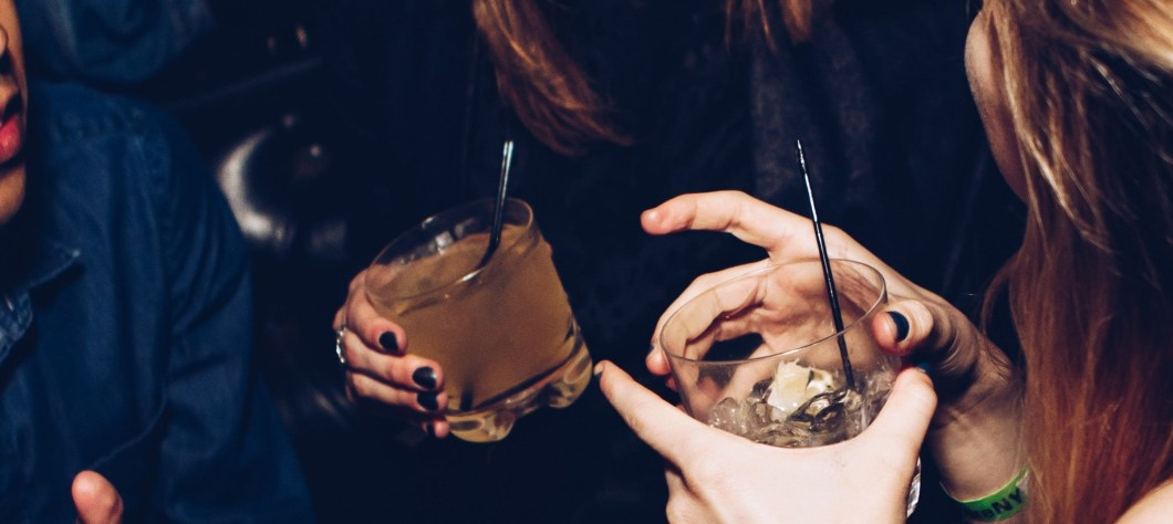 women laughing with drinks