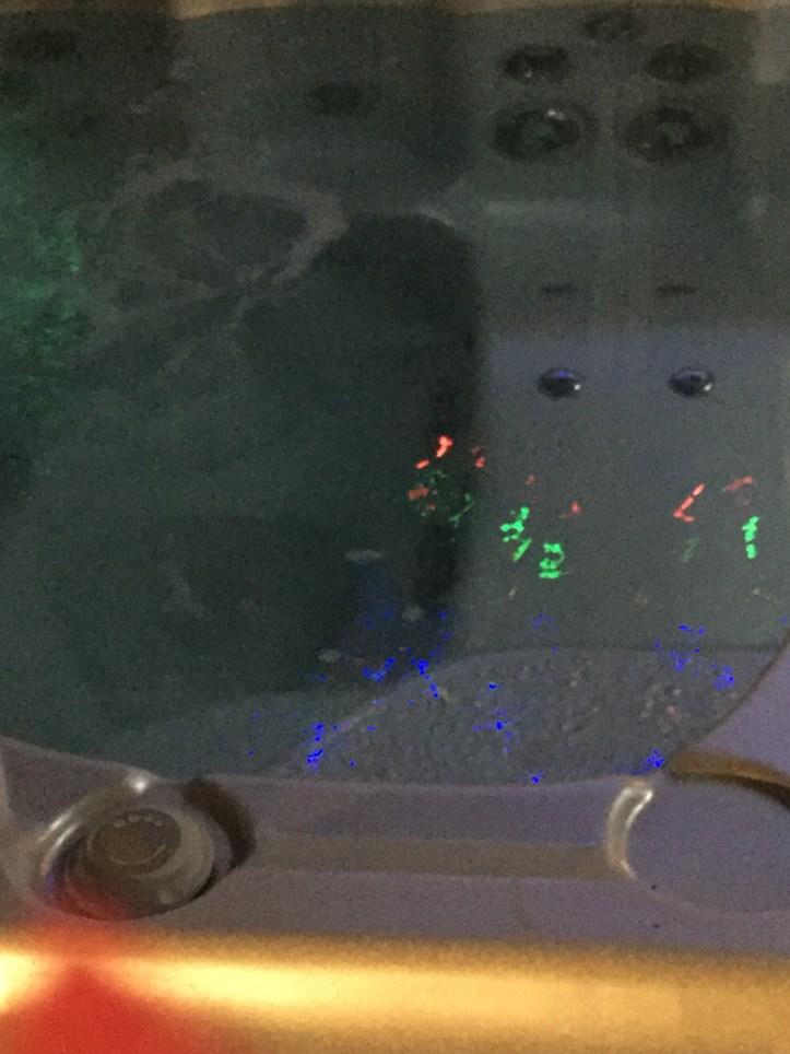 Lights glint off a jacuzzi