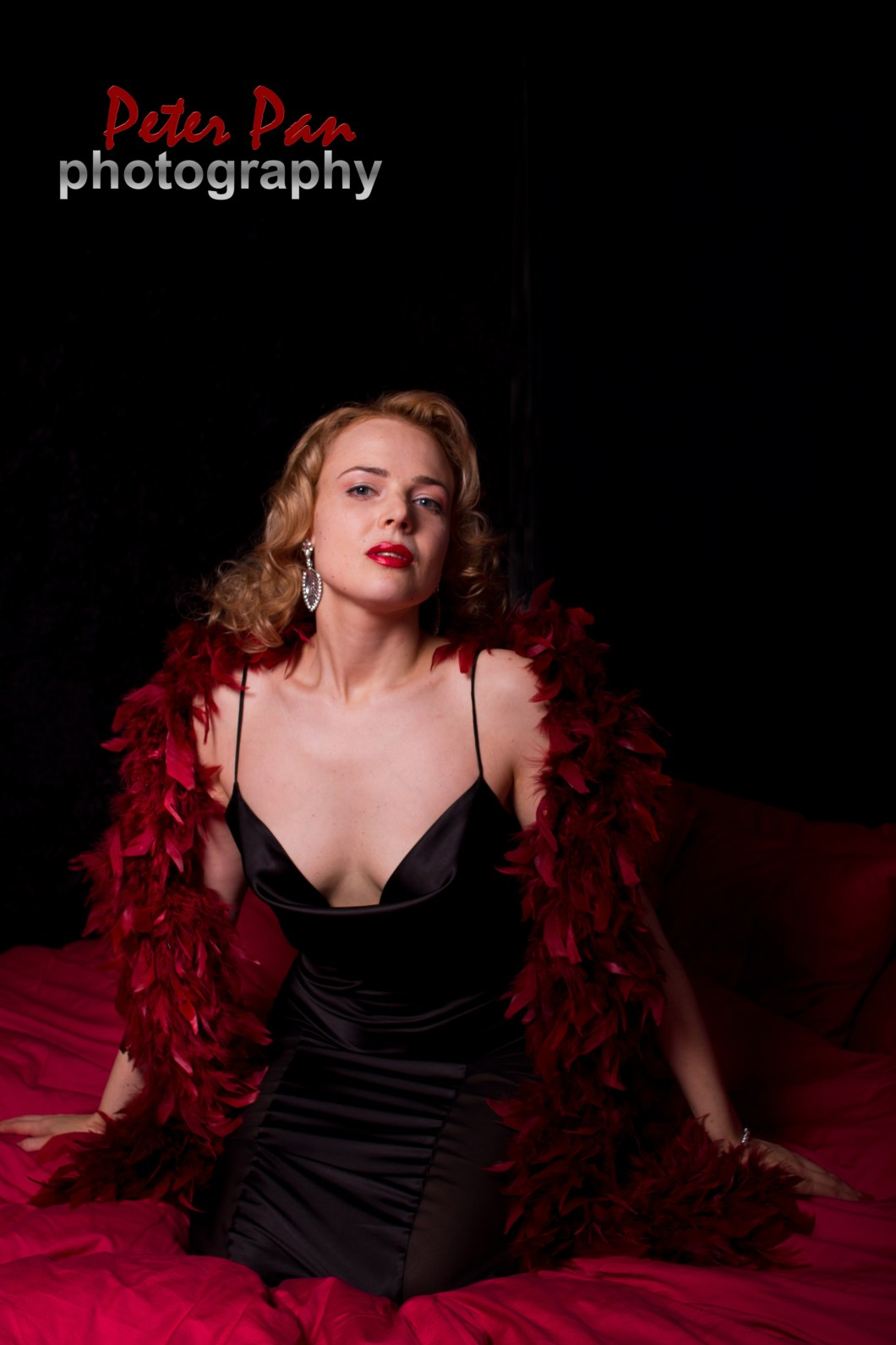 Lola Vavoom image with red boa and black dress by Peter Pan photography
