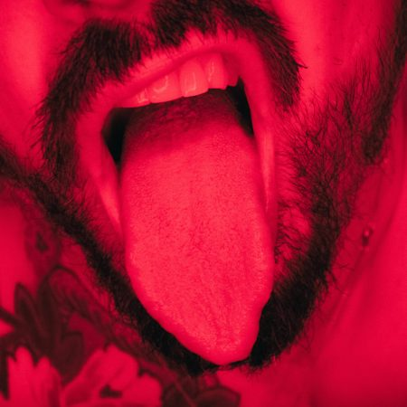 male bearded mouth teeth and lips in red light of a online sexworker