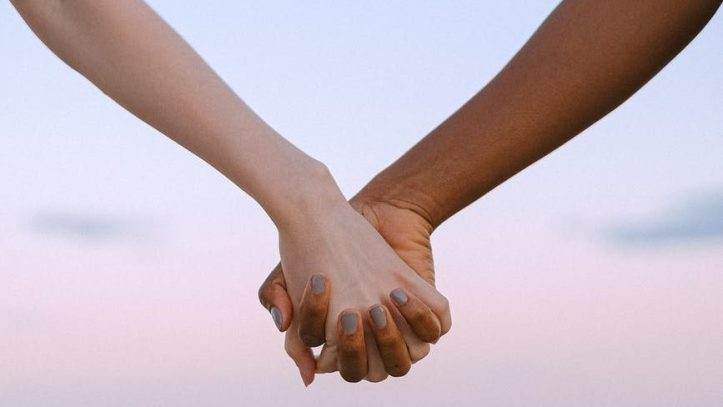 photo of people holding hands.  You cant rush trust