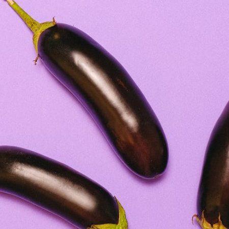 eggplants on light purple background