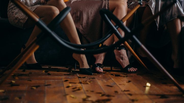 person wearing black sandals at a meeting or party.  Could you sell your old shoes on allthingsworn.com?