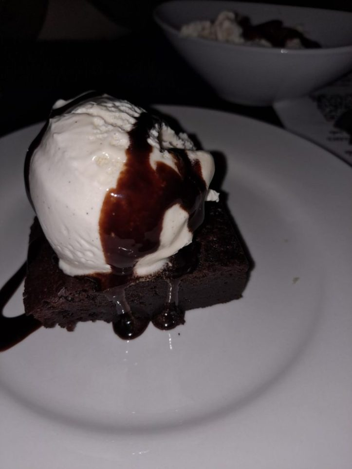 vegan brownie with ice cream at electrowerkz, eton mess in the background