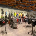Motorcross Custom Display Gear Hanging On Racks On The Store Ground And On The Store Walls