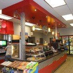 Universal Custom Display UCD Commercial Convenience Store Coffee Donut And Soda Display Branded Red Logos And Display Cases
