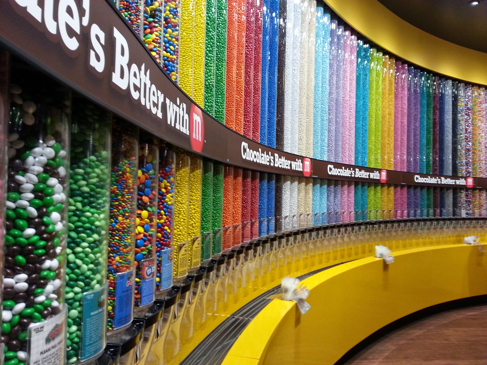 a large wall of candy dispensers