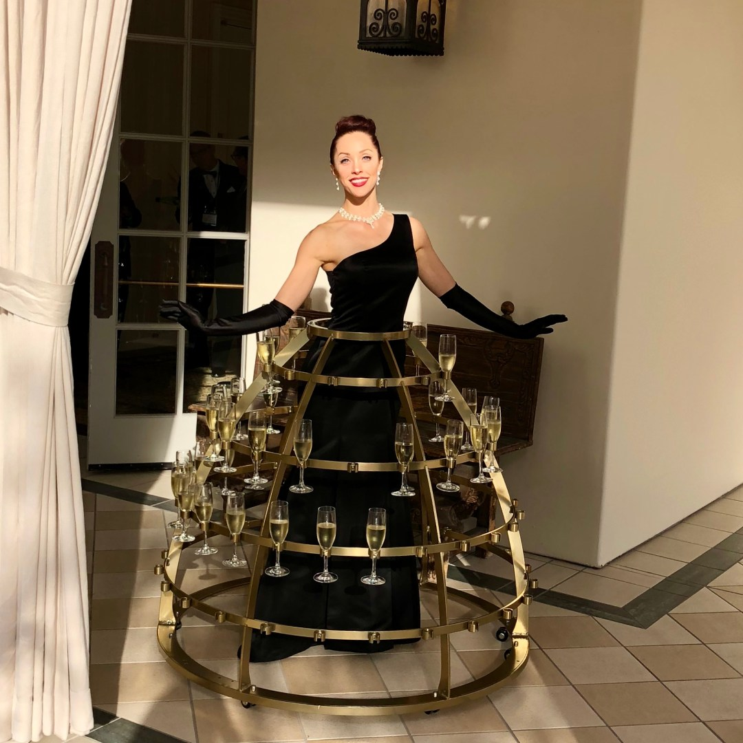 One gorgeous lady wearing a metal champagne skirt