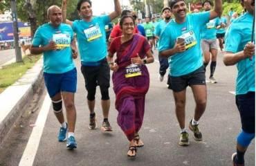 Indian-Woman-Running-Marathon-Wearing-Saree