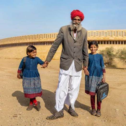 Father of Two Young School Girls in Sabyasachi Designed School Uniforms