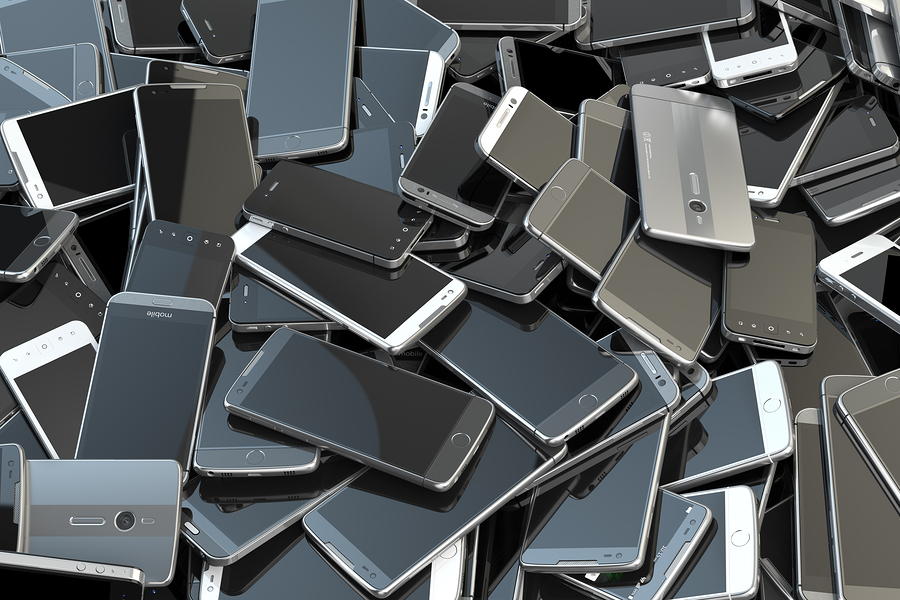 Heap of different smartphones. Mobile phone technology concept b