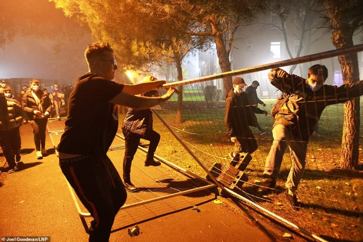 Manchester students taking down fences