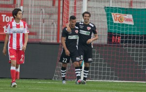 Benyamina and Doğan celebrate a goal