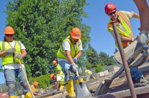 Dave Schutta (R) pours concrete for David St. John (L) and Jarvis Goodsky.