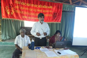 Leaders of the FTZGSE Union announce the reports findings to members in Sri Lanka.  President Anton Marcus on right.
