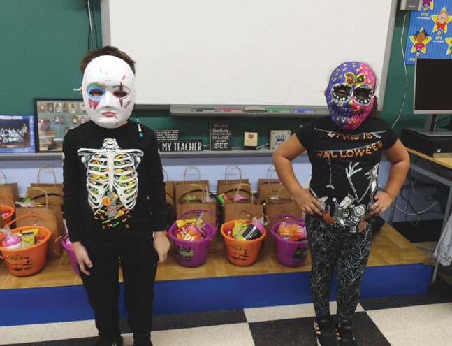 Students 'mask up' for a fresh twist on Halloween