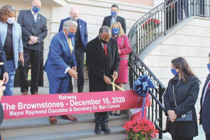 Ben Carson cuts ribbon as first phase is completed at the Brownstones in Rahway