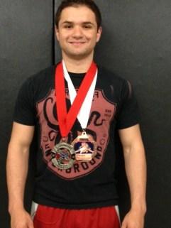 Michael Snediker medals at Fargo