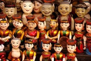Wooden dolls of the water theatre in Hanoi in Vietnam