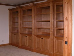 Alder bookcases with raised panel doors