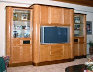 Heavy birds-eye maple cabinet with gloss finish.