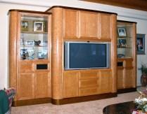 Heavy birds-eye maple cabinet with gloss finish.