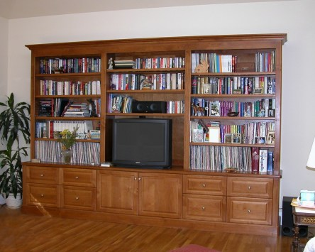 Alder bookshelves. Raised panel doors & drawers