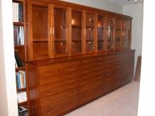 LED illuminated interiors in this cherry wood geo-specimen display cabinet