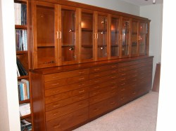 LED illuminated interiors in this cherry wood geo-specimen display cabinet