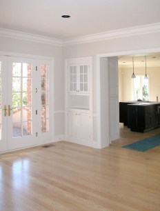 White painted inset cabinets. 6-lite glass upper doors
