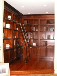 Lyptus wood cabinetry with red mahogany finish and rolling custom ladder