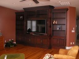 Mahogany TV cabinet & bookshelf. Bi-fold pocket doors. Glazed & shaded finish.