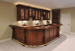 Mahogany Finished Bar with leaded glass doors & LED illumination.