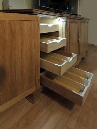 Door-switched LED illuminated interior lights. Dovetailed drawers on soft-close under-mount guides.