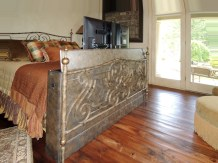 Faux finished cabinet made for motorized TV lift at the end of the bed.