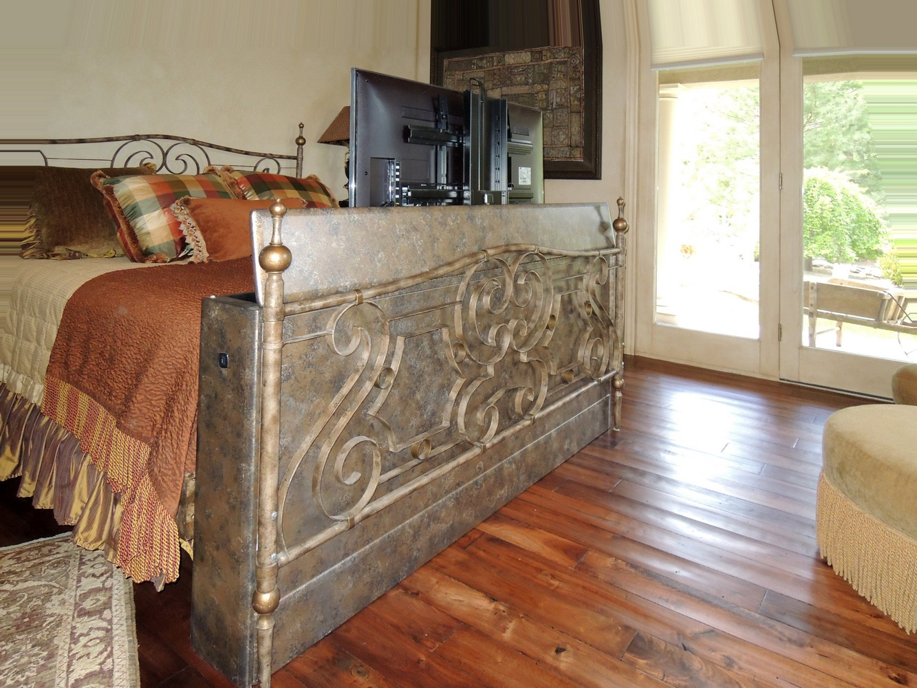 faux finished cabinet made for motorized tv lift at the end of the bed