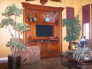 Inset alder Tuscan styled cabinet. Tubular columns, glazed & shaded finish.