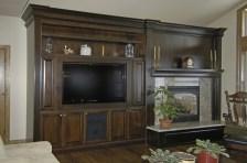 Dark walnut wall unit for AV, fireplace and display