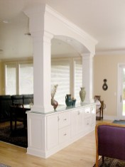 White painted room divider with storage below. Counter doubles as a convenient serving area.