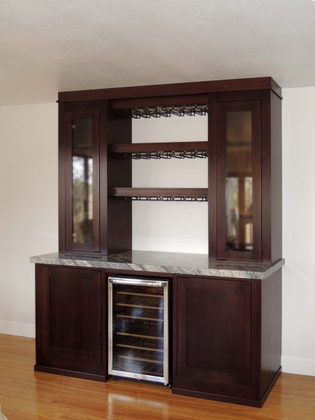 Mahogany adult beverage storage cabinets with LED illumination and granite counter top