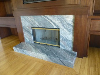 Mahogany fireplace surround with granite fireplace