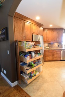 Full overlay maple wood cabinets with extra large pantry roll outs