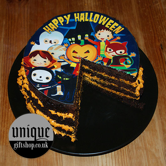 Halloween Cake Toppers Trick Or Treat on a cake with caramel filling