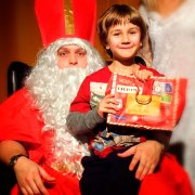 a man in St Nicholas costume with a boy