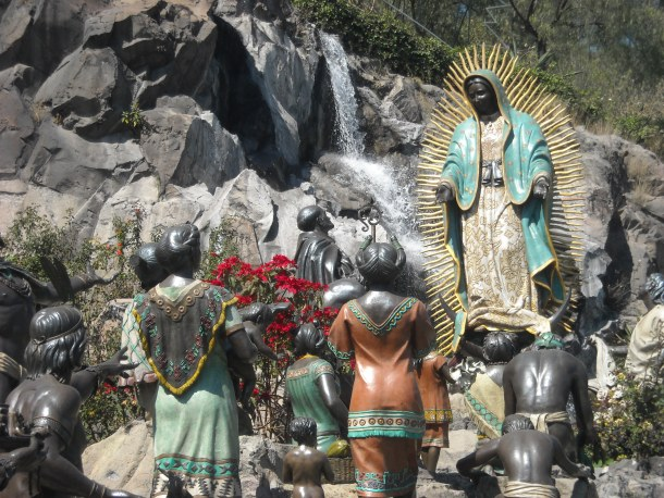 Statues of Our Lady of Guadalupe appearing to St. Juan Diego and indigenous people displayed at Tepeyac