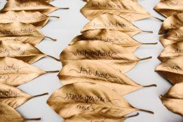 Gold Magnolia Leaf Escort Cards – shared on Southern Weddings Magazine